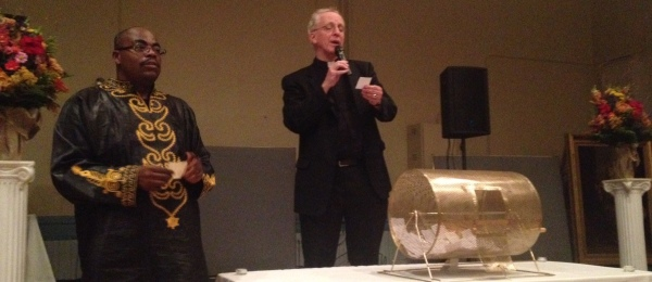 Deacon Leroy Branch and Father Robert Powers announce the winners of the parish's deluxe 50/50 raffle.